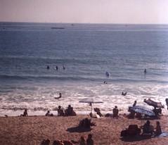 (spitting venom) Tags: ocean film beach 35mm nikon waves pacific sunny bluesky pacificocean shore surfers umbrellas westcoast nikonfm