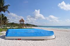 Beached Panga (mexicovisitor) Tags: tulum rivieramaya mexicancaribbean pangas lifeguardtower beaches