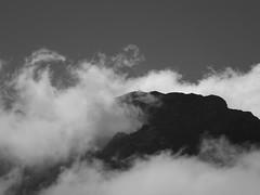 Hikers on the Glogghs ridge (lvalgaerts) Tags: switzerland schweiz melchsee frutt climbing mountain rock lake clouds summer sun black white church bonistock chapel glogghs
