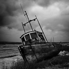 The Boat Graveyard curved (SAWPHOT0) Tags: august longexposure newbrighton rain shedrakes wirral workshop boat cloudy lightohouse mood wreck