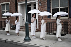 ladies in white (lucymagoo_images) Tags: philadelphia philly urban city sony rx100 southstreet performance umbrellas women walking