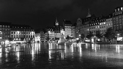 night city ... (lunaryuna) Tags: france lalsace strasbourg city nightcity citynights urbanconstructs place square architecture buildings rain night nightlights nightphotography nocturnalphotography walkinthecity pedestrians nightwalkers lightmood blackwhite bw monochrome lunaryuna placekleber