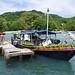Con una barca da 40 posti raggiungiamo il molo di Capurganà