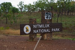 Nitmiluk National Park Entrance (huskyte77) Tags: road park trip travel november vacation sky brown building tree green nature grass sign stone closeup canon eos nationalpark bush flickr day view post outdoor oz timber side katherine australia soil national botanic outback gps aussie conceptual northern shoulder information gravel northernterritory nitmiluk 2470mm 2011 canoneos5d canonef2470mmf28l edithfallsroad werenbunaboriginalcommunity