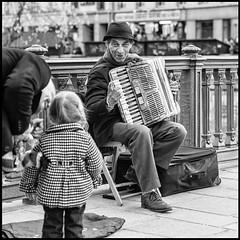 L'accordéoniste reconnaissant * Paris (sistereden2) Tags: bw square olympus f18 45mm omd musicien em5