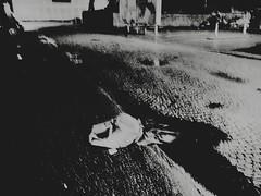 The Kid Was Almost Dead When I Arrived (Yves Roy) Tags: street city shadow urban blackandwhite bw black contrast dark austria blackwhite parkinglot raw moody darkness noiretblanc 28mm snap gloom yr enigmatic fav10 ricohgrd deepblack grdiii bureboke yvesroy yrphotography