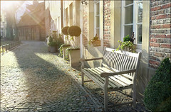 low wintersun (macfred64) Tags: germany bench cobblestone cobbles sunbeam textured homeland wintersun billerbeck elmarit24mmf28asph leicax1 johanniskirchebillerbeck