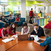 Students gather at a Hunt Library study table.