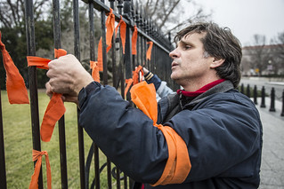 Witness Against Torture: Carmen Ties a Ribbon