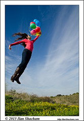 Girl flying with balloons (Ilan Shacham) Tags: flowers portrait sky color girl childhood youth clouds hair balloons fun outdoors israel flying child air balloon flight young helium innocence takingoff nesziona ilanshacham
