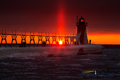 Sunset sent from Heaven (Northern Light Photography by Robert Byrne) Tags: winter sunset sun lighthouse ice water frozen michigan lakemichigan greatlakes icicle southhaven sunpillar southhavenlighthouse southhavenlight southhavensouthpierlights southpierlights