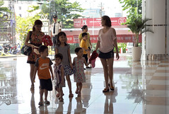 The wonder of it all (Roving I) Tags: families groups children arriving securityguards uniforms shopping shine tiles gloss smiles nike vietnam vincomcentre danang malls retail reflections