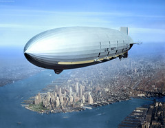 USS Macon (ZRS-5) Flying over New York Harbor, circa Summer 1933. The southern end of Manhattan Island is visible in the lower left center. (Jared Enos) Tags: zeppelin rigid airship air ship sky aircraft new york manhatten island city aerial history colorized colorization