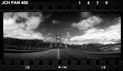 St. Johns Bridge and Moonset 16083218 (jimhairphoto) Tags: stjohns bridge portland pdx widelux panorama japancamerahunter jch streetpan 400 35mm film blackandwhite blancetnoir schwarzeaufweis blancoynegro blancinegre siyahrebeyaz jimhairphoto