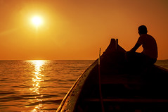 Bring me that horizon. (swearingpirate) Tags: boat evening orange sunset india travel tansport sun light golden silhoutte fading sea sky ocean