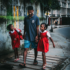 The way back (Richik_Phoenix) Tags: colour people street streetphotography india kolkata pupil student red girl children responsibility school childhood love