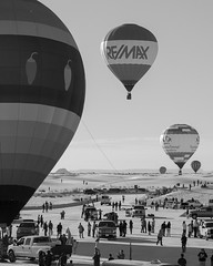 Set of balloons in the air at the 2016 White Sands ... (anwrak) Tags: hotair balloon tourism flight vehicle aircraft people group travel fly air sky soar black white
