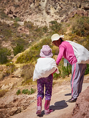 Mother and daughter work on salt pans (Lesmacphotos) Tags: peru travel work salt saltpans workers white mountain maras sacredvalley mother child family daughter girl sack