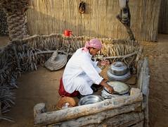 Breakfast in the desert (Tigra K) Tags: sharjah unitedarabemirates ae 2013 dubai fence lantern people wood working