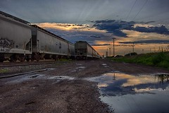 One last ride (TwinCitiesSeen) Tags: train reflection minnesota minneapolis twincitiesseen hdr canont3i tokina1224mm sunset