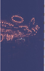 Child's Play (Cassandrea Xavier) Tags: film disposable 35mm disposablefilm filmcamera disposablecamera disposablefilmcamera vertical lights night nighttime cne canadiannationalexhibition amusementpark ride carousel
