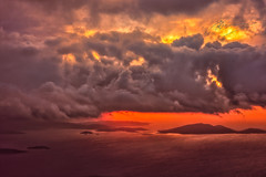 sunrise (dtsortanidis) Tags: travel red sea sky colors rain yellow clouds sunrise airplane island photography colorful purple athens greece windowseat dimitris dimitrios attiki tsortanidis dtsortanidis