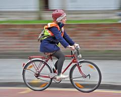 Little red riding helmet (jeremyhughes) Tags: street winter urban motion blur cold london bike bicycle speed cycling movement nikon cyclist helmet commuter commuting panning redhelmet hiviz hackneyroad redbike d700