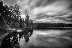 Silver lake (Mathijs Delva) Tags: longexposure trees blackandwhite bw lake nature water monochrome norway contrast reflections dark landscape island mono moving movement wind smooth pines le nd scape pinetrees protected uwa naturalreserve ultrawideangle finnemarka drinkablewater tokina1116f28