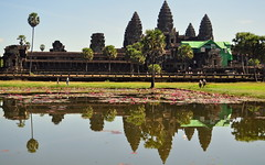 Reflection of Angkor Wat Temple, Cambodia (Vikas Aggarwal) Tags: world old blue sunset sky cloud lake man reflection building tree tower heritage monument rock stone facade sunrise river thailand temple mirror site ancient cambodia vishnu khmer exterior lotus buddha praying tomb ruin synagogue buddhism structure palm unesco made intelligence monsoon siem reap sacred tropical thom wisdom shiva angkor wat hinduism organization mekong built cultural phnom ziggurat obsolete ruined penh bayon scientific antiquities prohm raider