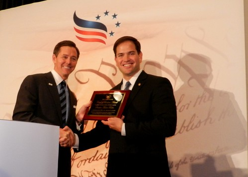 Ralph Reed giving Sen. Marco Rubio an award