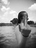 untitled (David M. Frazier) Tags: girls blackandwhite pool monochrome swimming sassy middlefinger fuckyou swimsuit bathingsuit