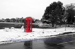 Village Green (Photographs by David Hollingworth) Tags: houses snow buildings village box roads telephonebox snowscene winterscene redtelephonebox villagegreen villagescene villagepond wetroads landscapeimage grassedareas selectivecolourimage