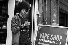 The Vape Shop (Cliff.j) Tags: street city urban man london eye sign shop wall youth grove candid sony afro watching headphones contact bracelets a7 ladbroke vape
