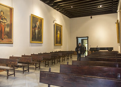 Alcazar Hall (Hans van der Boom) Tags: europe spain vacation holiday seville sevilla alcazar palace gardens hall salle pews benches paintings museum people sp