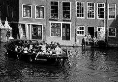 summer in Amsterdam (Gabi Wi) Tags: amsterdam summer sun bw gracht water people leisure boat sunbathe barechested reflexions outdoor