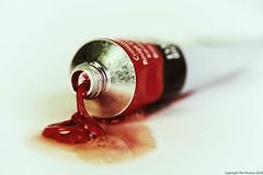 Leaking Oil Paint (PhilR1000) Tags: paint tube leak macro dof field depthoffield highkey vintage red macromondays thefirstletterofmyname