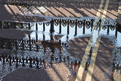 Hyde Pk. Corner 14sep16 (richardbw9) Tags: london uk england westminster hydeparkcorner apsleyhouse water reflection irongate ironwork doubleyellowlines puddle flow shadows shadowplay patterns city urban