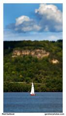 Red Sailboat (gardnerphotos.com) Tags: gardnerphotoscom lakepepin mississippiriver sailboat bluffs highway61
