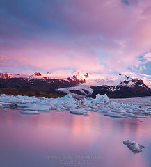 3:19 AM Sunrise Over Jokulsarlon Glacial Lagoon (Bridget Calip) Tags: ice clouds sunrise iceland movement rocks glacier iceberg jokulsarlon 2012 pinkclouds pinkskies floatingice blueice skaftafell glaciallagoon landofthemidnightsun calvingglacier oraefajokull bridgetcalip