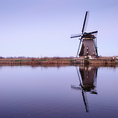 Wind and Water (ace_dave) Tags: holland netherlands thenetherlands kinderdijk zuidholland bluereflections dutchwindmills windandwater winterinthenetherlands nikon1024 nikond300s dikesandawindmill flatlandnearthewater