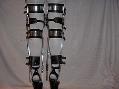Black KAFO Leg Braces with Double Buckled Cuffs Legs Together (KAFOmaker) Tags: leather metal high braces leg bondage strap heel cuff ankle brace sandal bracing restraint orthopedic braced