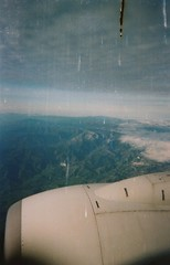 Plane (Mandy Warhol) Tags: camera mountains skye film plane damaged málaga disposable