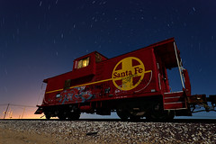 tail end charlie. boron, ca. 2012. (eyetwist) Tags: california longexposure railroad light red sky moon lightpainting santafe abandoned industry car yellow night train dark painting photography graffiti star nikon long exposure desert angle spin tripod wide perspective trails rusty rail wideangle caboose tagged fullmoon moonlit highdesert mojave transportation moonlight nikkor derelict gel nocturne arid trainspotting strobe startrails mojavedesert boron borax atsf eyetwist npy d7000 capturenx2 eyetwistkevinballuff nikond7000 1024mmf3545g