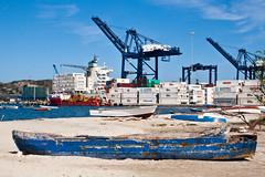 IMG_0160 (riconaranjo) Tags: ocean beach puerto boat mar dock colombia barco ship playa canoe santamarta canoa contenedores containers bote