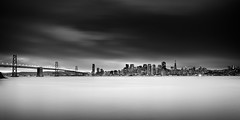 Last Photograph In 2012....... (M. Shaw) Tags: ocean sanfrancisco california lighting longexposure bridge sea bw building history water skyline architecture night clouds lights cityscape treasureisland cloudy panoramic historic baybridge embarcadero bayarea lighttrails transamerica citycenter californiacoast ndfilter cloudynight 1635mmf28l mshaw 5dmark2 canoneos5dmarkll 2x1crop silverefexpro2