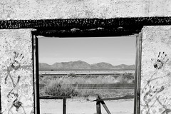 Framing the Arizona desert (kevin dooley) Tags: wood old city arizona blackandwhite bw southwest abandoned stone graffiti us hand desert peak az explore jail frame salome handprint 60 us60 oldjail harcuvar