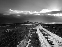 Thaw (simon ess) Tags: light sky blackandwhite sun snow monument monochrome wheel fence nikon staffordshire newcastleunderlyme 18105 lightandshade blackwhitephotos apedale alsagersbank scenicsnotjustlandscapes d7000