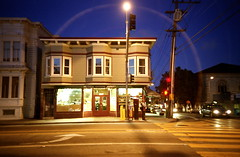streetlamp halo (troutfactory) Tags: sanfrancisco california film night streetlamp availablelight archive halo rangefinder lensflare sfbayarea missiondistrict analogue superia400 cosinacx2 c2003 valenciafarmersmarket