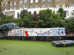 illustrated boat (squeezemonkey) Tags: london canal regentscanal grandunioncanal waterway decorated illustrations boat barge houses terrace rowingboat