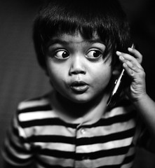 Spook Me !! (N A Y E E M) Tags: umar kalam son cellphone portrait lounge home night rabiarahmanlane chittagong bangladesh availablelight indoors waistlevel square cropped lulu